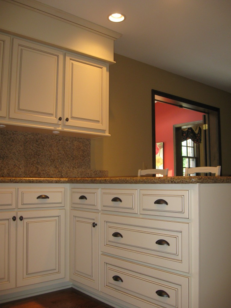 Dark oak cabinets refaced in solid maple with glazed off-white finish