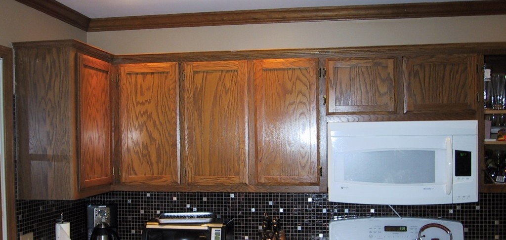 Basic oak builder's grade cabinets that we will be refacing in solid cherry