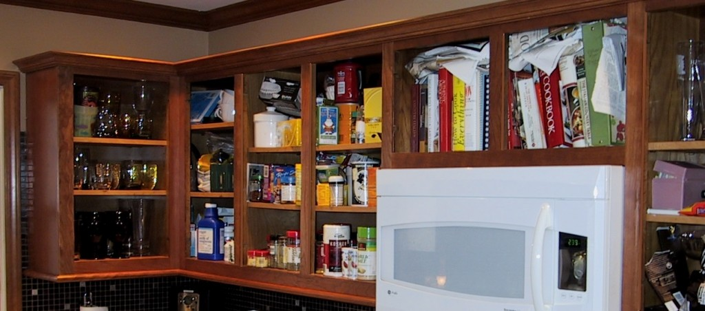 Here ere the cabinets covered in solid cherry with new crown and under-cabinet moldings installed