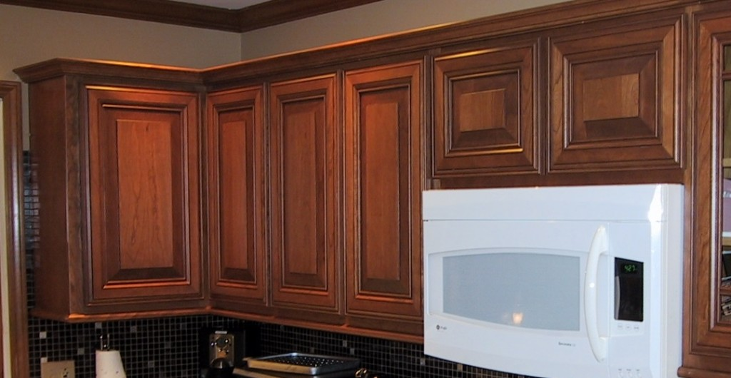 The new cherry raised-panel doors have been installed with concealed hinges.